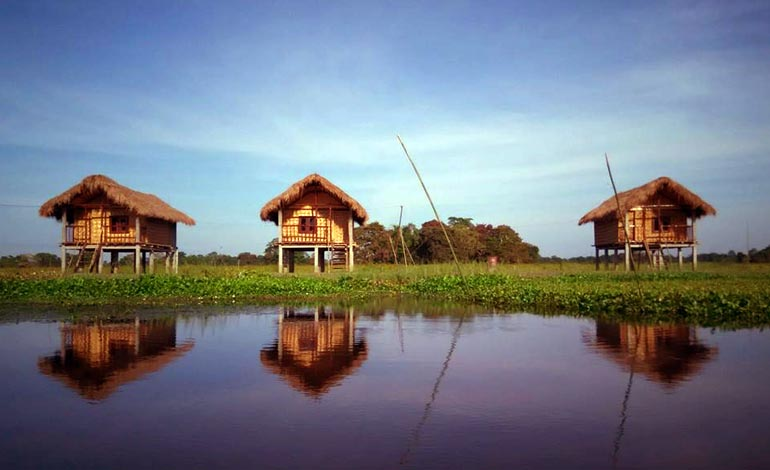 10 places to visit in india before they disappear majuli cottages