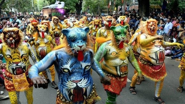 Onam celebrations men on road painted as tiger